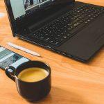 computer with coffee mug and phone